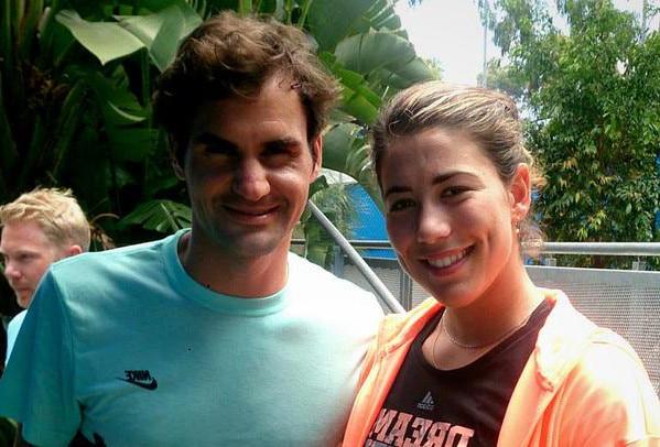 Foto: Garbiñe Muguruza y Roger Federer