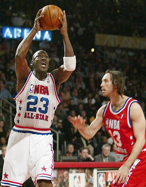 BKN-ALL STAR-JORDAN 5:JTH07 - 20030209 - ATLANTA, GA, UNITED STATES : NBA All-Star Michael Jordan (L) of the Washington Wizards drives to the basket past Steve Nash of the Dallas Mavericks, 09 February 2003, during the NBA All-Star game at Philips Arena in Atlanta, Georgia. Jordan started in place of Vince Carter who was voted onto the team, but elected to give Jordan his starting spot.