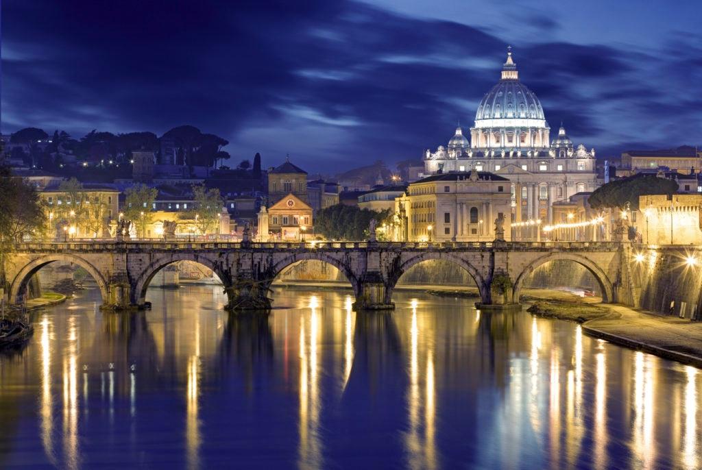 Night image of St. Peter's Basilica, Ponte Sant Angelo and Tiber