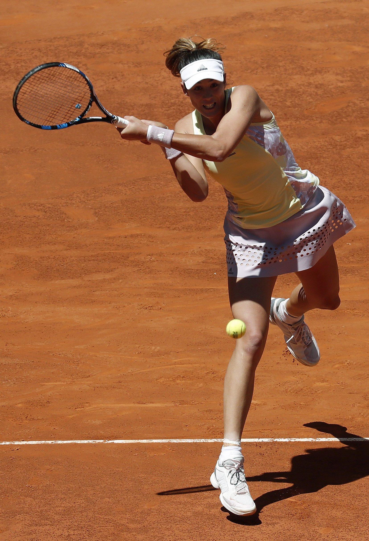 Fotografía de Garbiñe Muguruza resta una pelota en su debut en el Madrid Open 2016