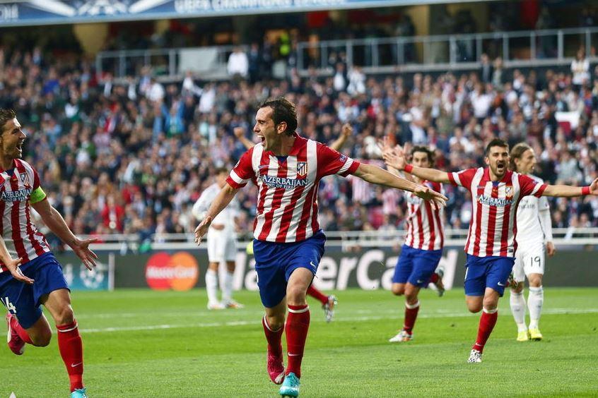 Godín celebra el primer tanto marcando en la final de Lisboa | Foto: EFE