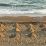 playa-espana-sombrilla-arena-verano-turismo-bbva