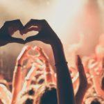 people-enjoying-rock-concert-with-heartshape-hand-gesture, festival, celebración