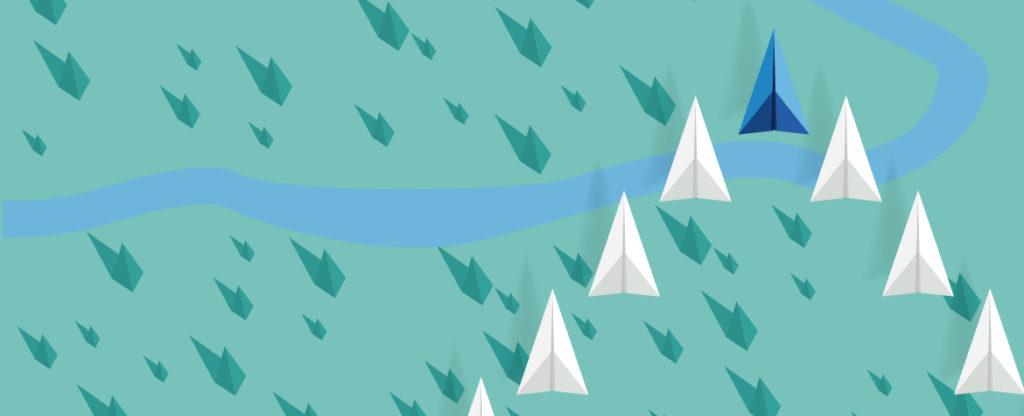 Fotografía de aviones de papel sobre fondo verde BBVA