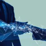 Fotografía de estrechar manos, cerrar un trato, blockchain, tecnología, préstamos corporativos BBVA