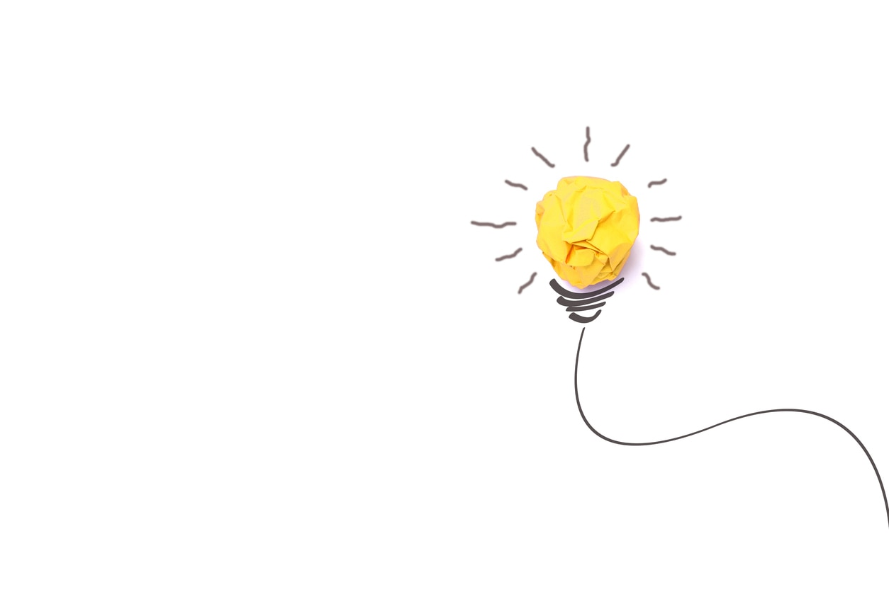 Concept idea with paper light bulb isolate on white background