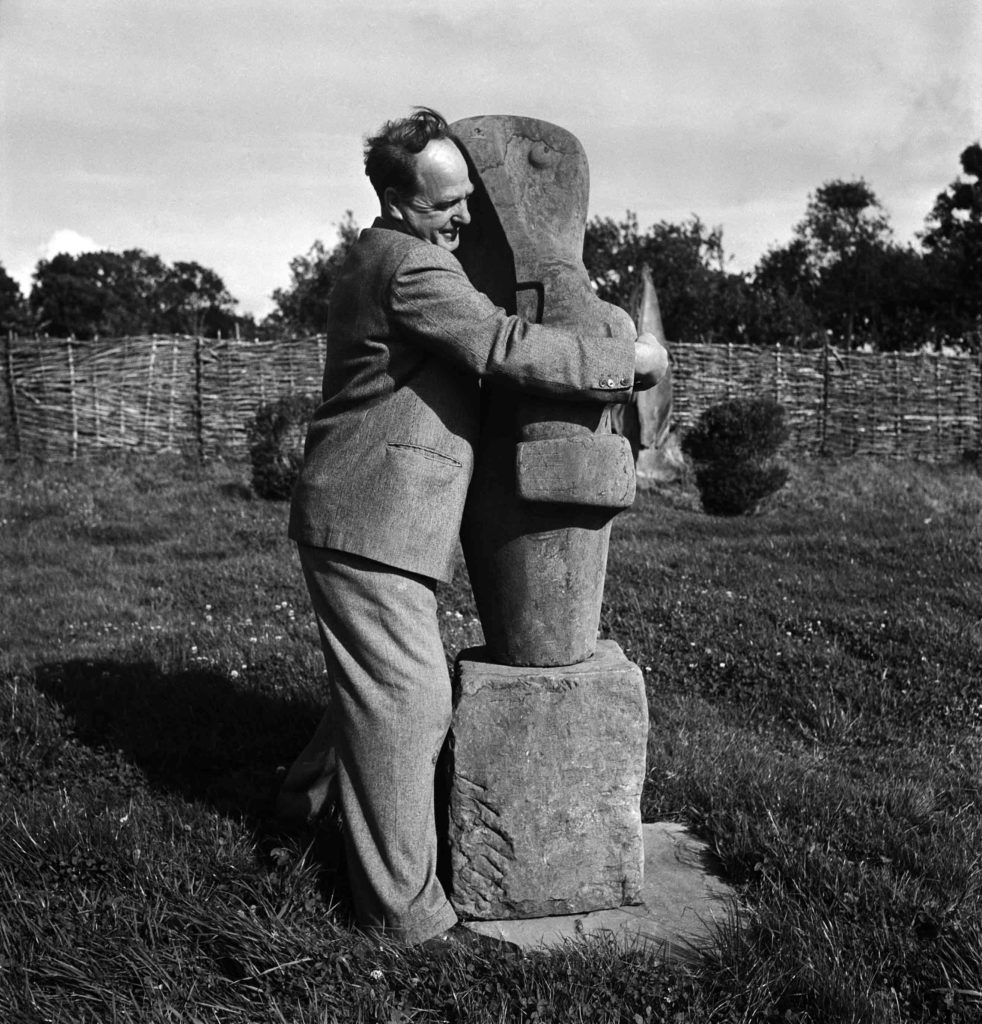 Henry Moore with his sculpture Mother and Child, Farley Farm, England, 1953