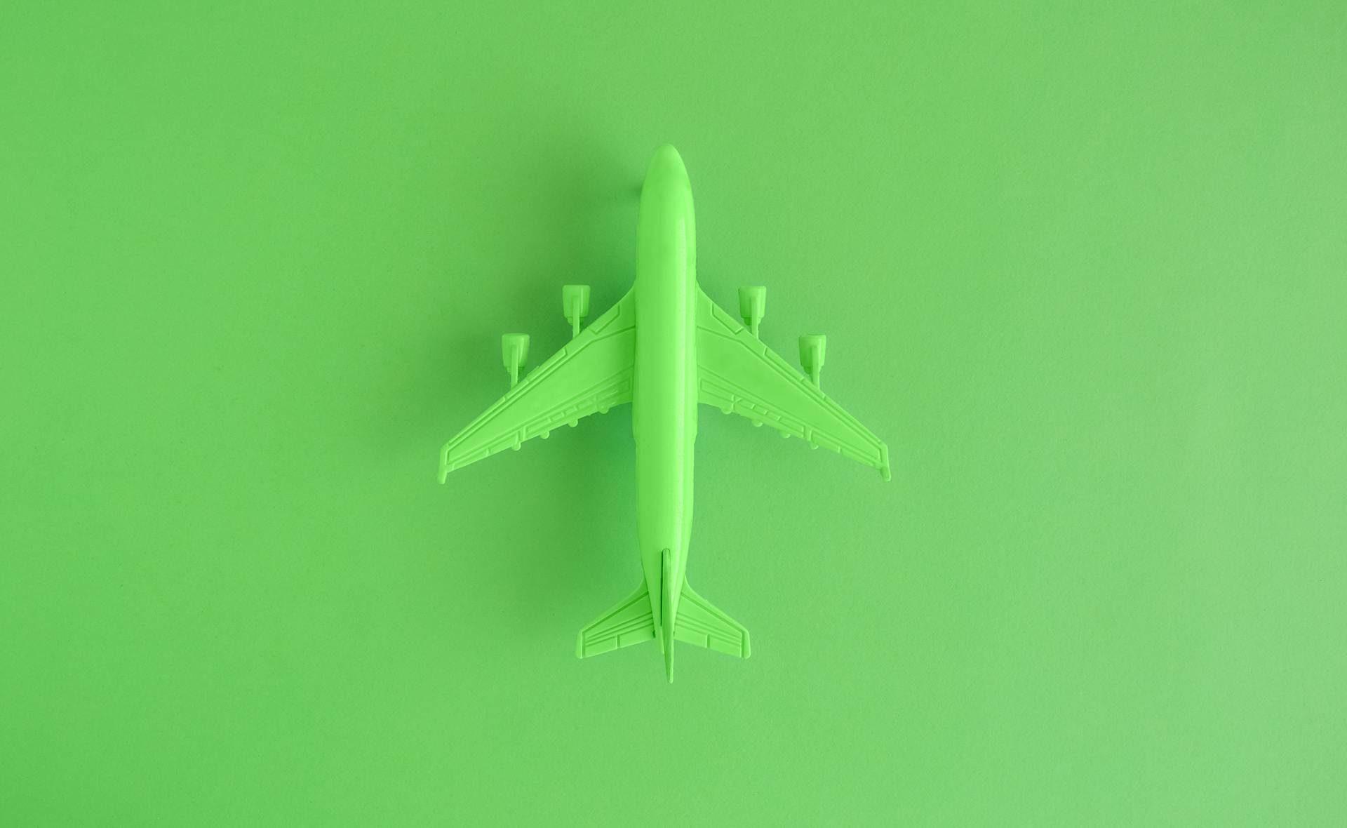 Fotografía de Avión, verde, aeropuerto, sostenible, finanzas, sostenibilidad, juguete