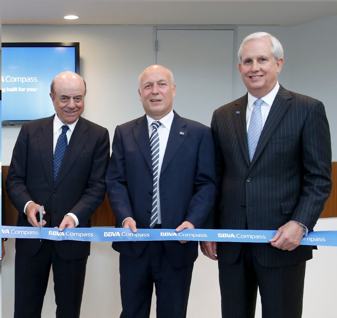 From left, Francisco Gonzalez, Manolo Sanchez, and Jim Heslop perform a ribbon cutting at the BBVA in Houston 2013
