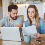 millennial computer woman man house resource bbva