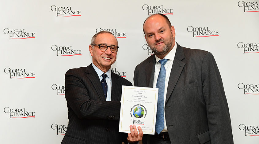 Alexis Thompson, Head of Global Securites Services, receiving the Best Custodian in Spain awards certificates from Global Finance Publisher and Editorial Director, Joseph Giarraputo.