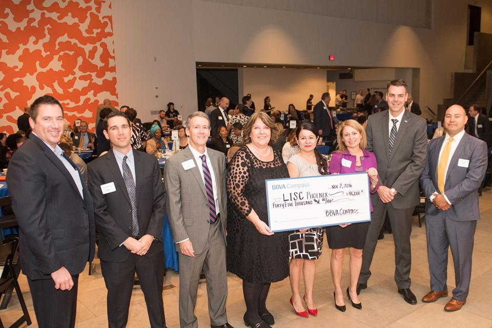 Members of LISC Phoenix and BBVA Compass pose with the $45,000 grant check at the 2016 LISC Phoenix Annual Breakfast.