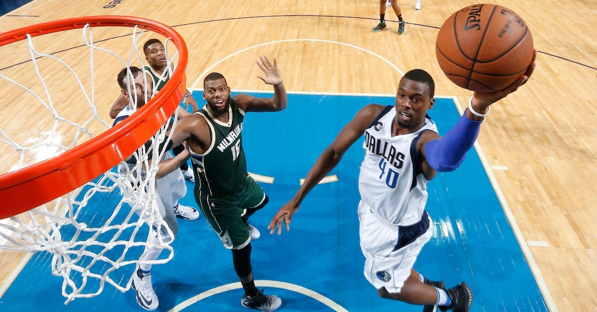 DALLAS, TX - NOVEMBER 6: Harrison Barnes #40 of the Dallas Mavericks shoot the game tying shot to send the game into overtime against the Milwaukee Bucks on November 6, 2016 at the American Airlines Center in Dallas, Texas. NOTE TO USER: User expressly acknowledges and agrees that, by downloading and or using this photograph, User is consenting to the terms and conditions of the Getty Images License Agreement. Mandatory Copyright Notice: Copyright 2016 NBAE (Photo by Glenn James/NBAE via Getty Images)