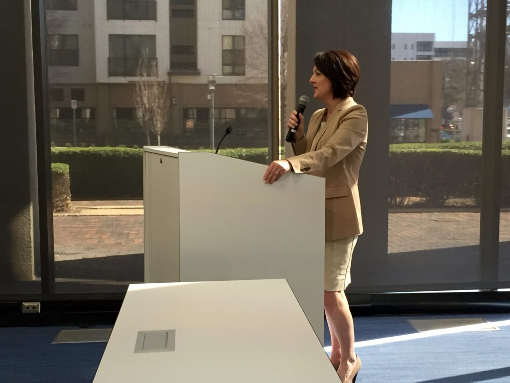 BBVA Compass Birmingham Market CEO Andrea Smith welcomes the contestants to the Next Gen semi-finals held at the bank's Development Center.