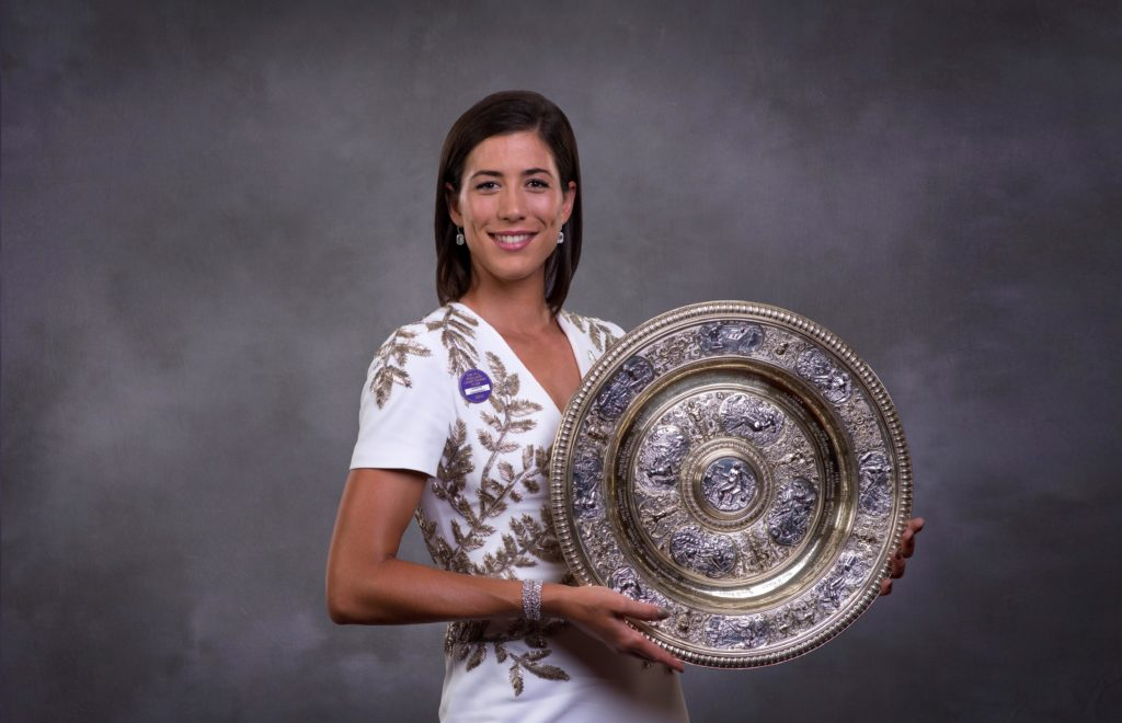 Garbiñe Muguruza with Wimbledon trophy