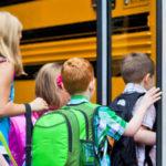 children-boarding-school-bus